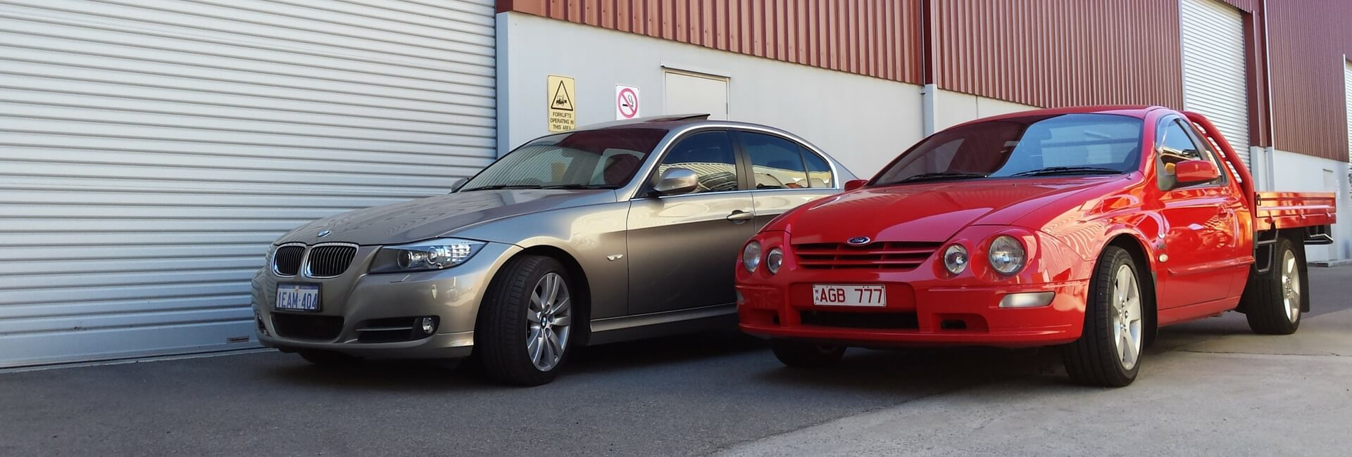 Many different types of vehicles are stored at AGB , such as these fine examples of a BMW 3201, and Ford Falcon XR8 AU11 Ute