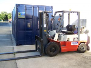 AGB 's forklift is patiently waiting to do the heavy lifting of Storage Crates or any pallets of goods