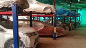 Many cars are stored inside to keep them safe from inclement weather