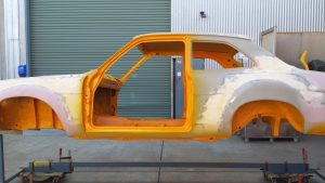 My 1972 TC Ford Escort on the rotisserie having attention to panel and paintwork